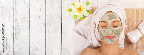 Fotobehang Spa Young healthy woman with face clay mask.
