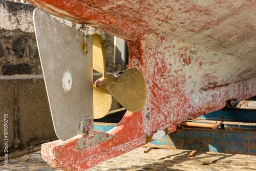 Keuken foto achterwand Schip Propeller and rudder of an old fishing boat in detail