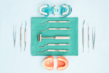 dentist tools and orthodontic on color background, flat lay, top vipw.