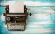 Leinwandbild Motiv Vintage typewriter header with old paper. retro machine technology - top view and creative flat lay design.