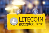 virtual money Litecoin cryptocurrency - Litecoin (LTC) currency accepted here - sign on glass door - 189922342
