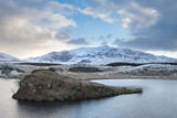 Beautiful long exposure Winter landscape image of Llyn y Dywarchen in Snowdonia National Park - 189932789