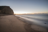 Beautiful vibrant long exposure sunrise landscape image of West Bay in Dorset England - 189933915