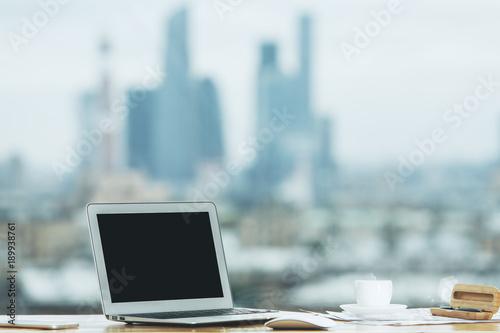 Creative desk with empty laptop