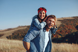 Happy young couple enjoys a sunny day in nature - 189943334