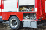 The fire truck is red. Fire and rescue equipment in a fire truck.