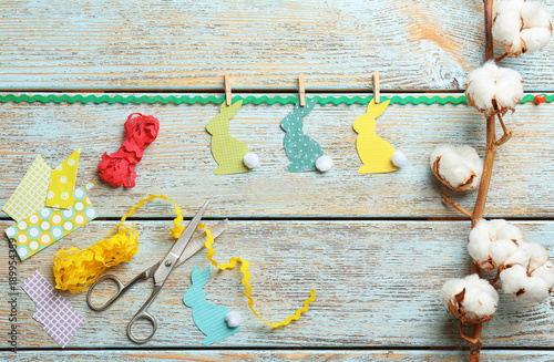 Easter bunny decorations, scissors and cotton flowers on wooden background - 189954359