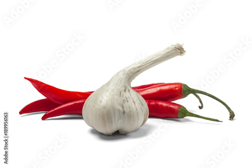 Deurstickers Hot chili peppers Red hot chili pepper and garlic isolated on white background.