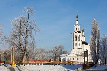 Winter landscape: Suspension Bridge and Epiphany Church. Russia, the city of Orel
