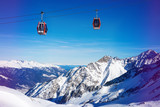 ski resort cable cars over beautiful mountain landscape at Italy Alps