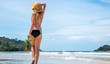 Quadro beautiful girl with a straw hat and a walking pineapple on an exotic beach, good food and rest