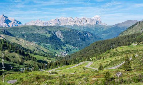 Foto op Canvas Pistache mountain landscape in summer in Trentino Alto Adige. View from Passo Rolle, Italian Dolomites, Trento, Italy. Mountain road - serpentine in the mountains Dolomites, Italy