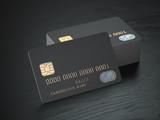 Stack of black blank credit cards mockup on black wood table background, - 189983502
