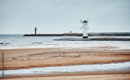 Windmill lighthouse in Swinoujscie on a cloudy day, color toned picture, Poland.