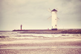 Windmill lighthouse in Swinoujscie on a cloudy day, color toned picture, Poland. - 190002916