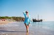 Quadro Happy woman is walking on the beach.