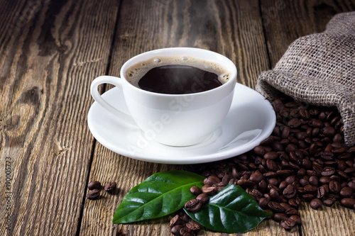 Poster Koffiebonen Cup of coffee on wooden rustic table