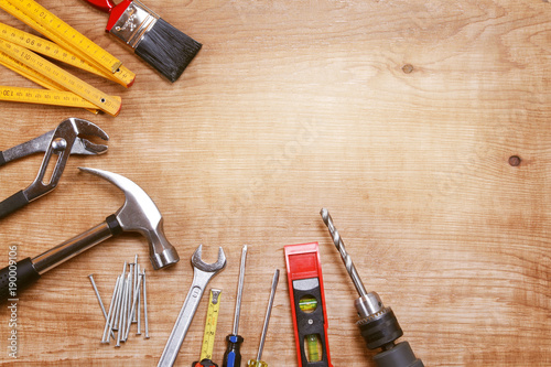 Assorted hand tools on wooden background - 190009106