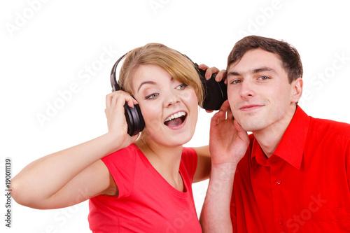 Fotobehang Muziek Couple two friends with headphones listening to music