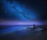 Starry night sky over sea and beach with man silhouette - 190013771