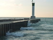 Pier on Lake Huron in Grand Bend Ontario Canada winter sunset