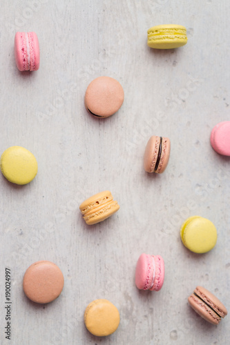 Aluminium Macarons Macaron vertical background. Macarons are small round delicious french confections, made with meringue and sweet flavored filling. Often found in french bakeries, these tasty treats are light & crisp!