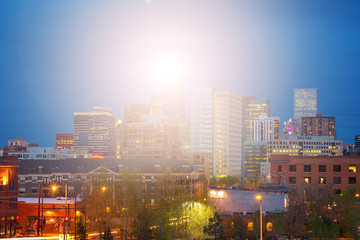 Denver Colorado bright sunlight shining above the downtown skyline