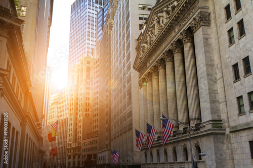 Sunlight shines on the historic buildings of the financial district in lower Manhattan, New York City near Wall Street