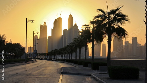 Foto op Plexiglas Dubai the skyline of Dubai marina from the artificial Palm Jumeirah island under the sunrise