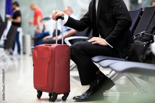 A businessman sitting in the airport.