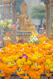 Bangkok, Thailand - January 27, 2018 : Flowers gifts for buddhist worship at the Erawan Shrine in Bangkok, Thailand
