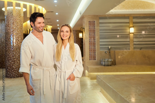 Leinwanddruck Bild A couple in the bathrobes at the spa is resting.