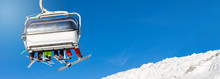 """Постер, картина, фотообои """"skiers and snowboarders in a ski lift against clear blue sky. blank space for text"""""""