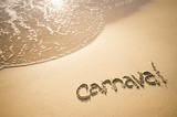 Message for Carnaval written on smooth sand beach in Rio de Janeiro, Brazil