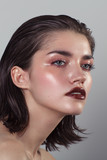 Beauty portrait of woman with wet skin and and dark lipstick - 190084132