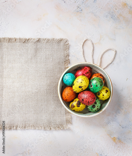 Colored easter eggs on a light canvas background,place for text