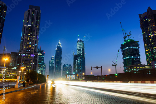 Foto op Plexiglas Dubai Dubai night city scene with light trails