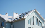 Modern passive house with white roof and solar panels for energy saving and energy efficiency. - 190090987