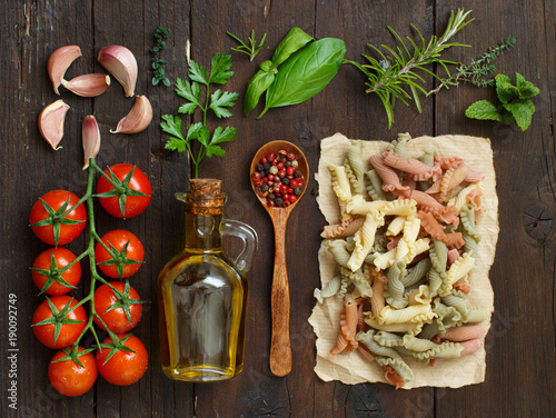 Wall mural Tricolor pasta, vegetables, herbs and olive oil