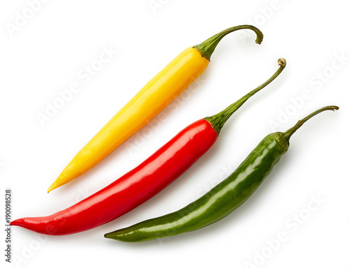 Fotobehang Hot chili peppers Three colorful chili peppers