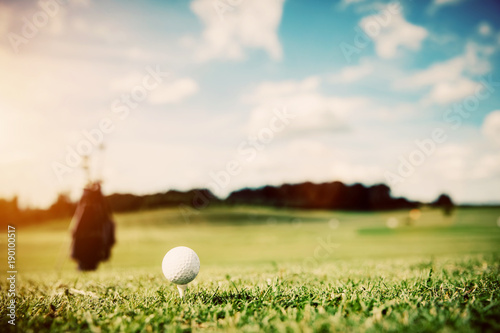 White golf ball on a green grass
