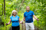 Senior marriage trekking together in the woods. - 190100984