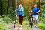 Senior couple enjoying their walk in the forest. - 190101314