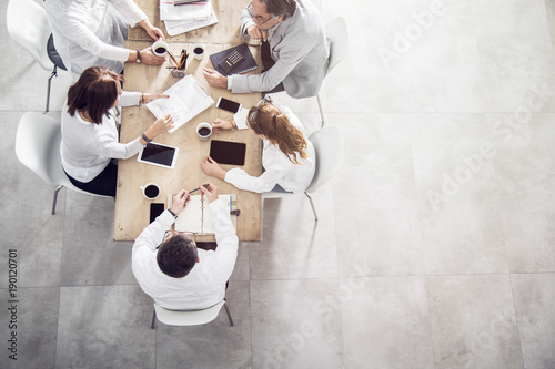 Top view in office while people having a meeting