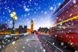 Big Ben and Westminster bridge on a cold winter night with falling snow, London, United Kingdom - 190121110