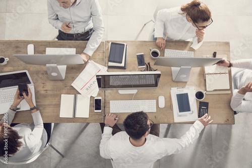 Business table and workers in meeting