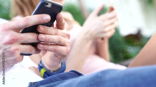 Closeup of people using smartphone