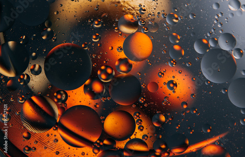 Abstract space background. Water drops of different colours