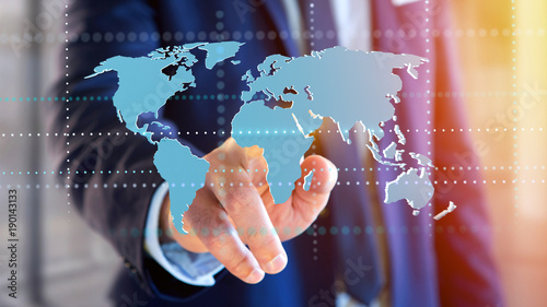 Businessman holding a Connected world map on a futuristic interface - 3d render