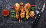 Grilled chicken legs with spices and garlic. - 190155317